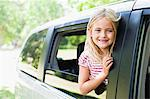 Smiling girl standing in car window Stock Photo - Premium Royalty-Free, Artist: Blend Images, Code: 649-06717281