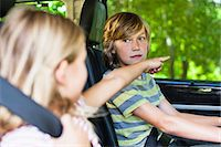 Children sitting in backseat of car Stock Photo - Premium Royalty-Freenull, Code: 649-06717283