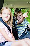 Children sitting in backseat of car Stock Photo - Premium Royalty-Free, Artist: Robert Harding Images, Code: 649-06717284