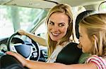 Mother and daughter talking in car Stock Photo - Premium Royalty-Free, Artist: Blend Images, Code: 649-06717285