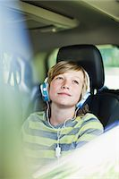 Boy listening to headphones in car Stock Photo - Premium Royalty-Freenull, Code: 649-06717291