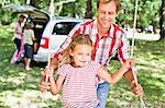 Father pushing daughter on swing Stock Photo - Premium Royalty-Free, Artist: Blend Images, Code: 649-06717297