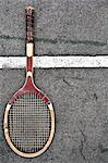 Tennis racket on court Stock Photo - Premium Royalty-Free, Artist: Ron Fehling, Code: 649-06717344