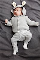 Baby boy laying on bed Stock Photo - Premium Royalty-Freenull, Code: 649-06717447
