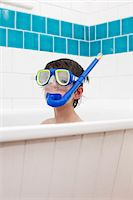 Boy wearing snorkel mask in bath Stock Photo - Premium Royalty-Freenull, Code: 649-06717466