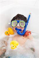 Boy wearing snorkel mask in bath Stock Photo - Premium Royalty-Freenull, Code: 649-06717468