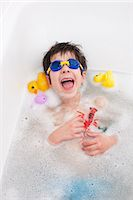 Boy in snorkel mask laughing in bath Stock Photo - Premium Royalty-Freenull, Code: 649-06717469