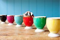 savings - Egg cup full of money on desk Stock Photo - Premium Royalty-Freenull, Code: 649-06717485
