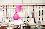 Pink bra hanging in kitchen Stock Photo - Premium Royalty-Free, Artist: Blend Images, Code: 649-06717488