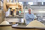Worker with machinery in biscuit factory Stock Photo - Premium Royalty-Freenull, Code: 649-06717642
