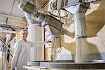 Worker with machinery in biscuit factory Stock Photo - Premium Royalty-Freenull, Code: 649-06717648