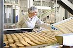 Worker checking production line in factory Stock Photo - Premium Royalty-Freenull, Code: 649-06717650