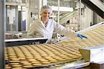 Worker checking production line in factory Stock Photo - Premium Royalty-Free, Artist: Blend Images, Code: 649-06717651