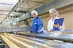 Worker checking production line in factory Stock Photo - Premium Royalty-Freenull, Code: 649-06717654