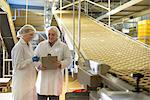 Workers talking in biscuit factory Stock Photo - Premium Royalty-Freenull, Code: 649-06717662