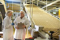 Workers talking in biscuit factory Stock Photo - Premium Royalty-Freenull, Code: 649-06717663