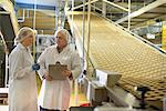 Workers talking in biscuit factory Stock Photo - Premium Royalty-Free, Artist: Robert Harding Images, Code: 649-06717663