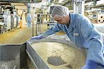 Worker with machinery in biscuit factory Stock Photo - Premium Royalty-Freenull, Code: 649-06717672