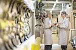 Workers talking in biscuit factory Stock Photo - Premium Royalty-Free, Artist: Blend Images, Code: 649-06717674
