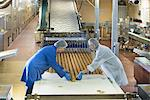Workers packing in biscuit factory Stock Photo - Premium Royalty-Free, Artist: Derek Shapton, Code: 649-06717679