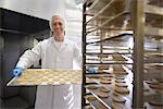 Worker baking biscuits in factory Stock Photo - Premium Royalty-Freenull, Code: 649-06717687
