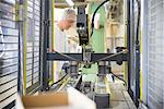 Worker with machinery in biscuit factory Stock Photo - Premium Royalty-Freenull, Code: 649-06717708
