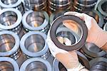 Worker holding steel ring in factory Stock Photo - Premium Royalty-Free, Artist: Blend Images, Code: 649-06717711
