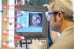 Engineer using computer in factory Stock Photo - Premium Royalty-Free, Artist: Blend Images, Code: 649-06717725