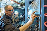 Engineer operating machinery in factory Stock Photo - Premium Royalty-Free, Artist: CulturaRM, Code: 649-06717728