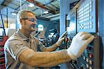 Engineer operating machinery in factory Stock Photo - Premium Royalty-Free, Artist: Blend Images, Code: 649-06717729
