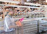 Worker examining loom in textile mill Stock Photo - Premium Royalty-Free, Artist: Cultura RM, Code: 649-06717734