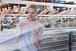 Worker examining loom in textile mill Stock Photo - Premium Royalty-Free, Artist: Robert Harding Images, Code: 649-06717735
