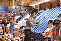 Worker examining loom in textile mill Stock Photo - Premium Royalty-Freenull, Code: 649-06717744