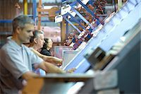 Workers examining loom in textile mill Stock Photo - Premium Royalty-Freenull, Code: 649-06717745