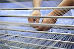 Worker adjusting threads on loom Stock Photo - Premium Royalty-Free, Artist: Puzant Apkarian, Code: 649-06717751