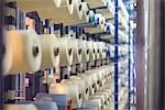 Bobbins of thread in textile mill Stock Photo - Premium Royalty-Freenull, Code: 649-06717752