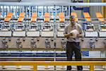 Workers examining thread in textile mill Stock Photo - Premium Royalty-Free, Artist: Blend Images, Code: 649-06717753