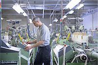 production - Worker using loom in textile mill Stock Photo - Premium Royalty-Freenull, Code: 649-06717759