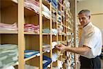 Worker examining fabric in textile mill Stock Photo - Premium Royalty-Free, Artist: Cultura RM, Code: 649-06717765