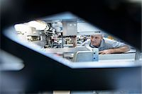 production - Worker using machinery in textile mill Stock Photo - Premium Royalty-Freenull, Code: 649-06717783