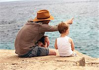 Father and son overlooking ocean Stock Photo - Premium Royalty-Freenull, Code: 649-06717803