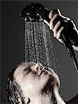 Woman washing face in shower Stock Photo - Premium Royalty-Free, Artist: Blend Images, Code: 649-06717897