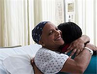 Daughter hugging mother at hospital Stock Photo - Premium Royalty-Freenull, Code: 614-06718039