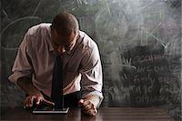 Man using digital tablet Stock Photo - Premium Royalty-Freenull, Code: 614-06718126