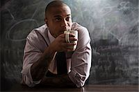 Man drinking cup of coffee Stock Photo - Premium Royalty-Freenull, Code: 614-06718128