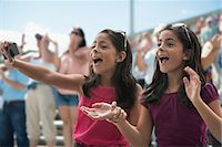 Two excited girls at a pop concert Stock Photo - Premium Royalty-Freenull, Code: 614-06718152