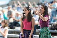 Two excited girls at a pop concert Stock Photo - Premium Royalty-Freenull, Code: 614-06718153