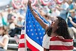 Girl at rally holding up american flag Stock Photo - Premium Royalty-Free, Artist: CulturaRM, Code: 614-06718160