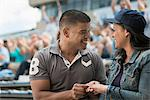 Couple getting engaged at sports game Stock Photo - Premium Royalty-Free, Artist: foodanddrinkphotos, Code: 614-06718195