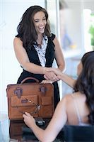 fat lady sitting - Businesswomen shaking hands in office Stock Photo - Premium Royalty-Freenull, Code: 614-06718303